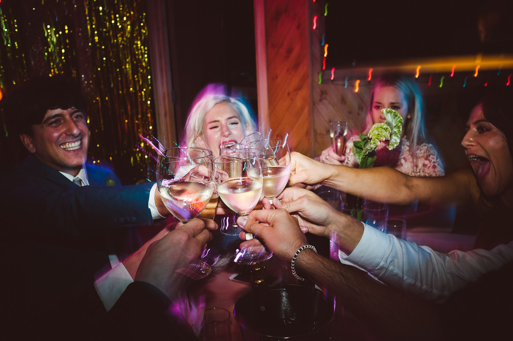 weddings guests doing cheers