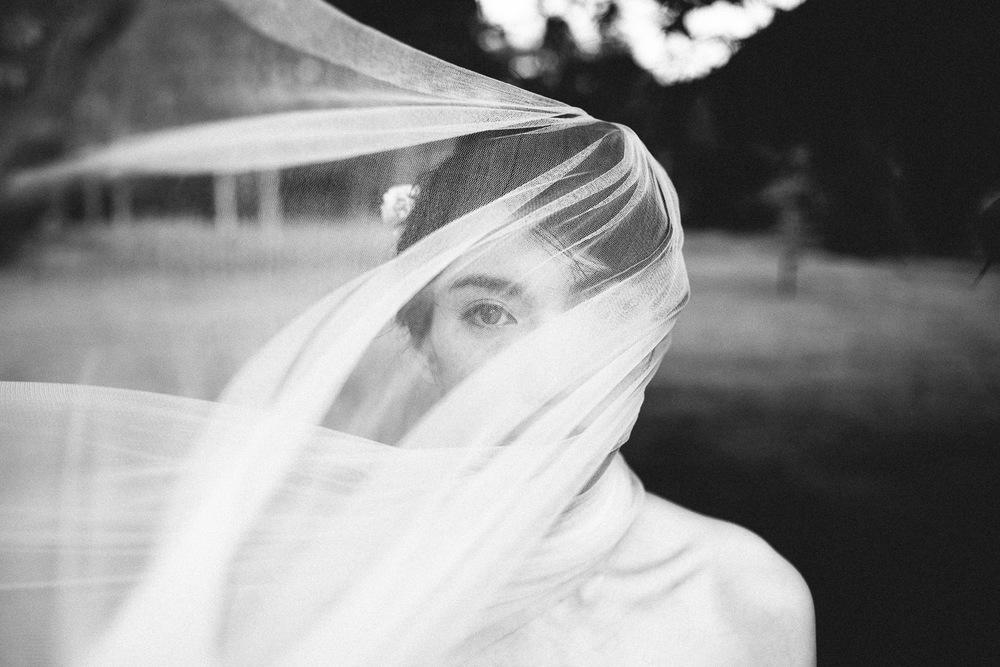 bride looking through her wedding veil