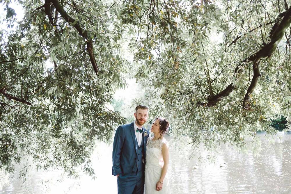 bride looks at groom loving