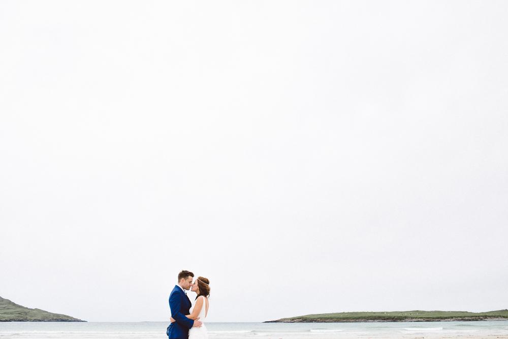 bride and groom against big sky