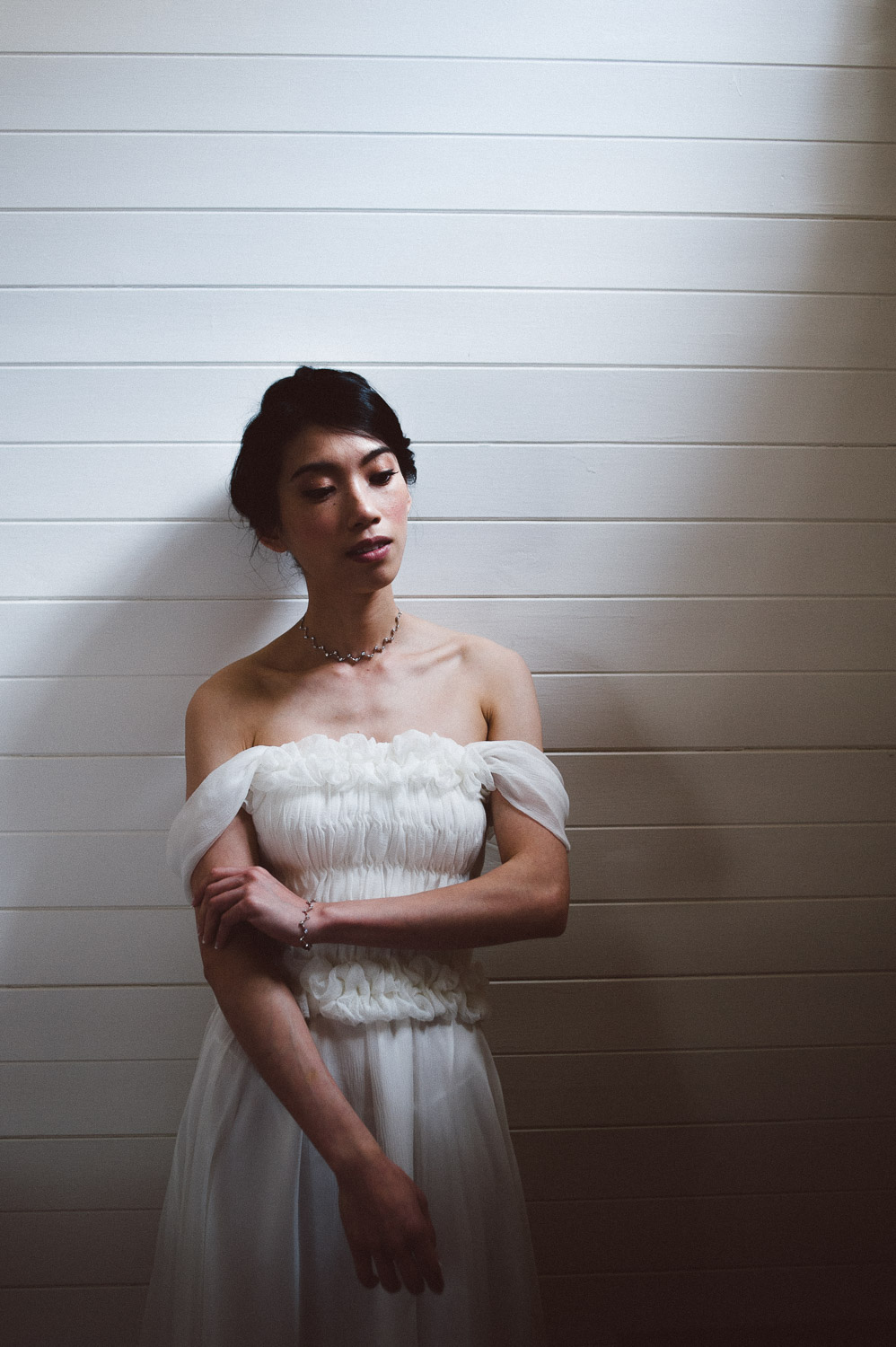 bride stand in beautiful window light