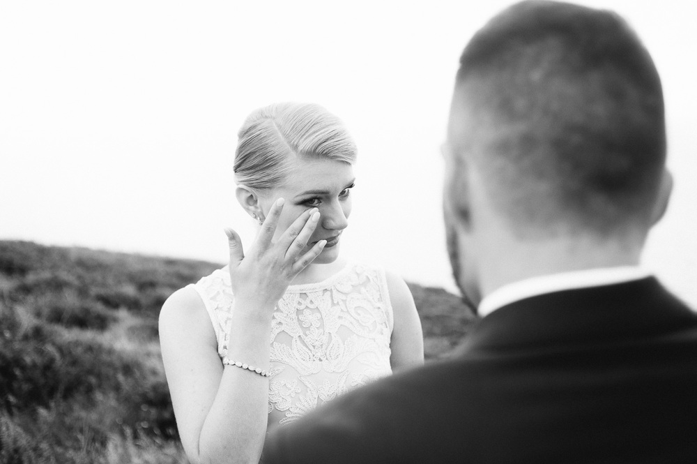 bride wipes tear away during vows