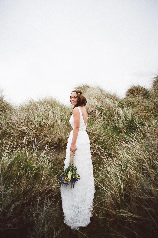 bride walking in long grass