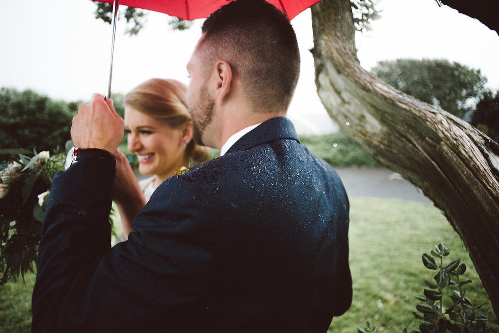 rain drops on grooms shoulder