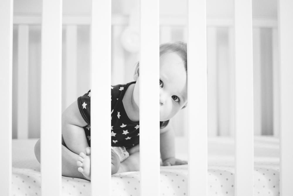 baby taking through cot