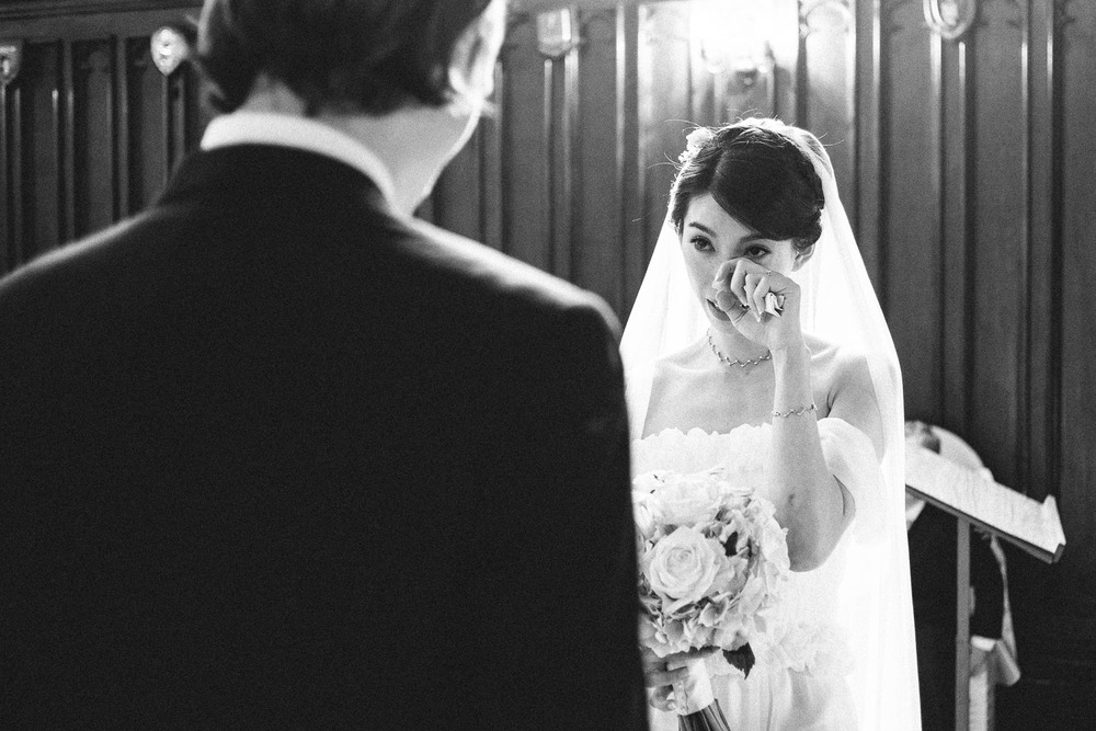 bride wipes tear away from face