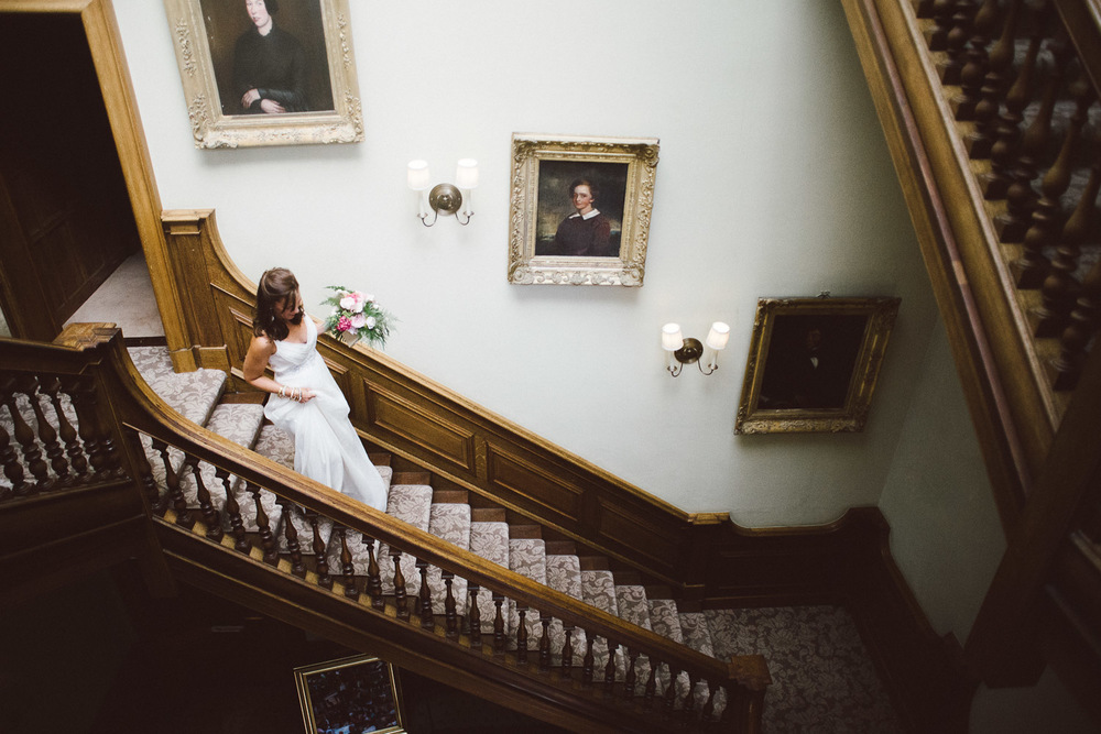bride walking down stairs in her dress