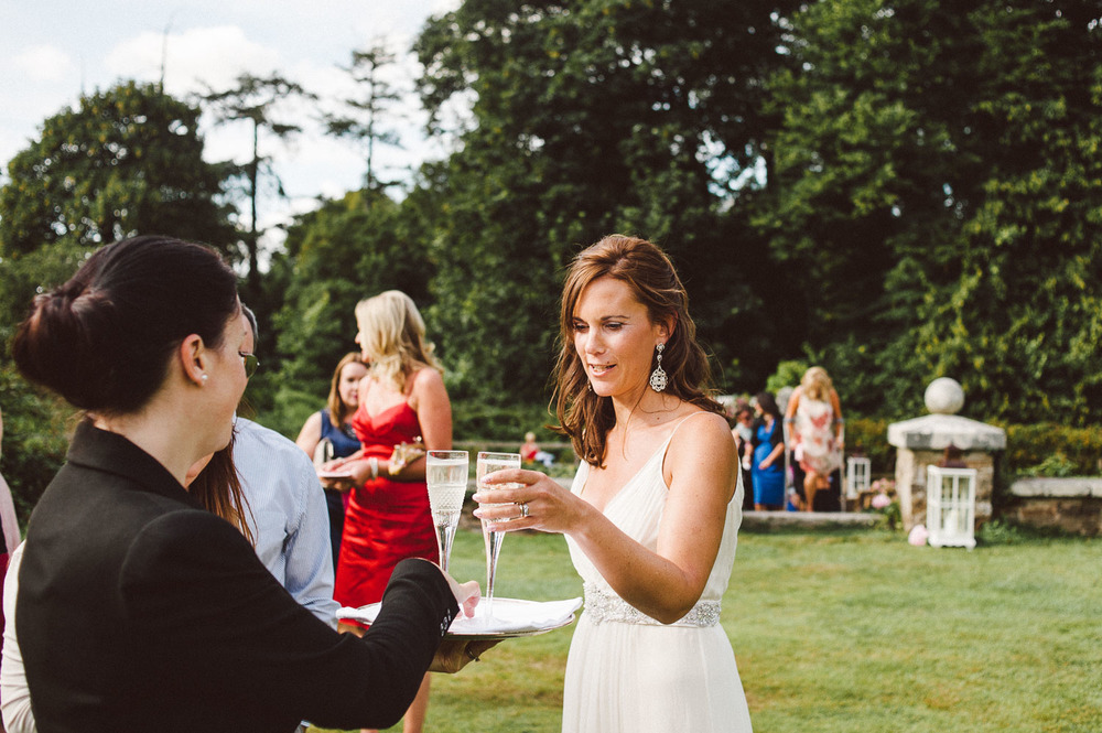 bride takes a glass of champagne