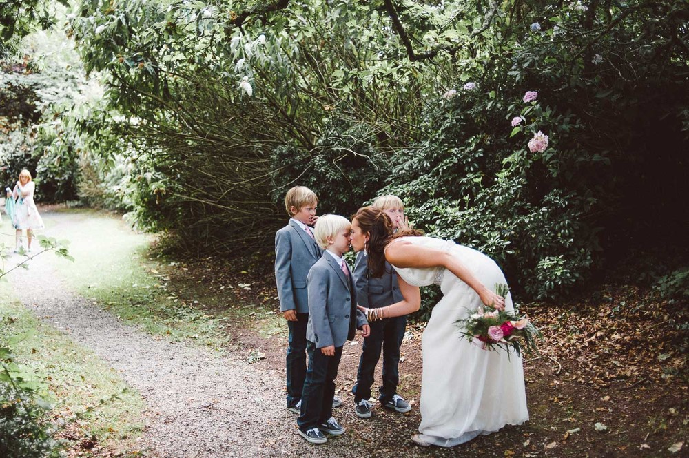 bride kisses her boys