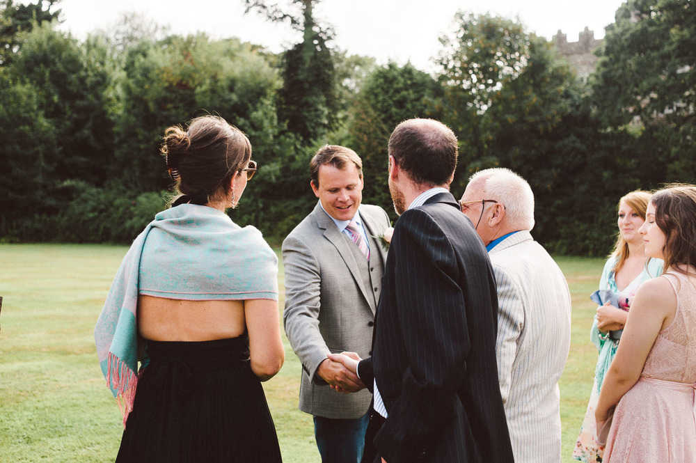 groom shakes guests hands