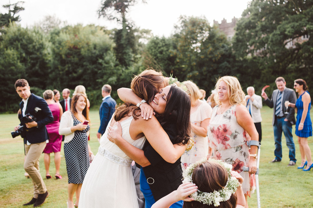 bride hugs her wedding guests