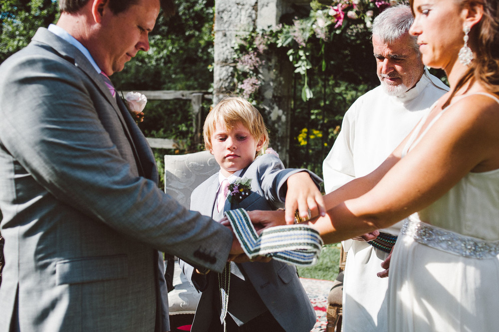 little boy ties knot for his parents