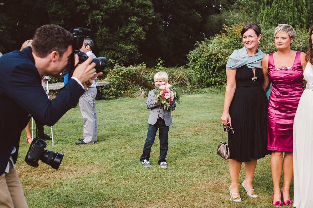 photographer takes photos of wedding guests