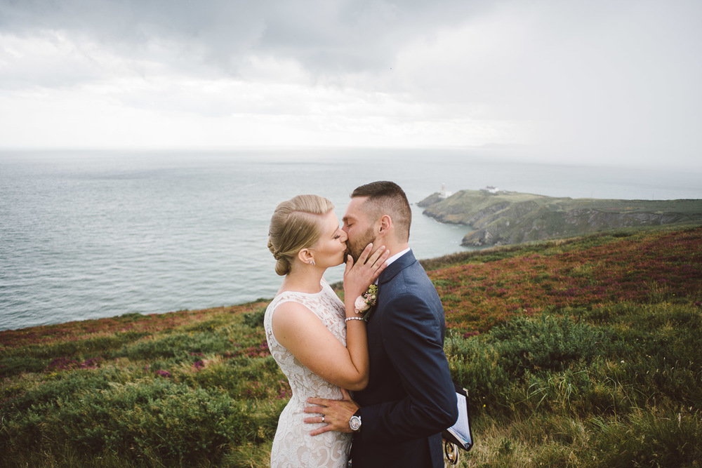 bride and groom kiss on howth head