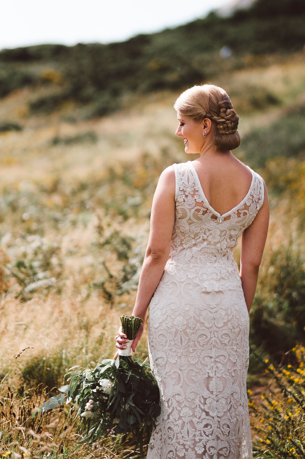 view of brides dress from back with flowers