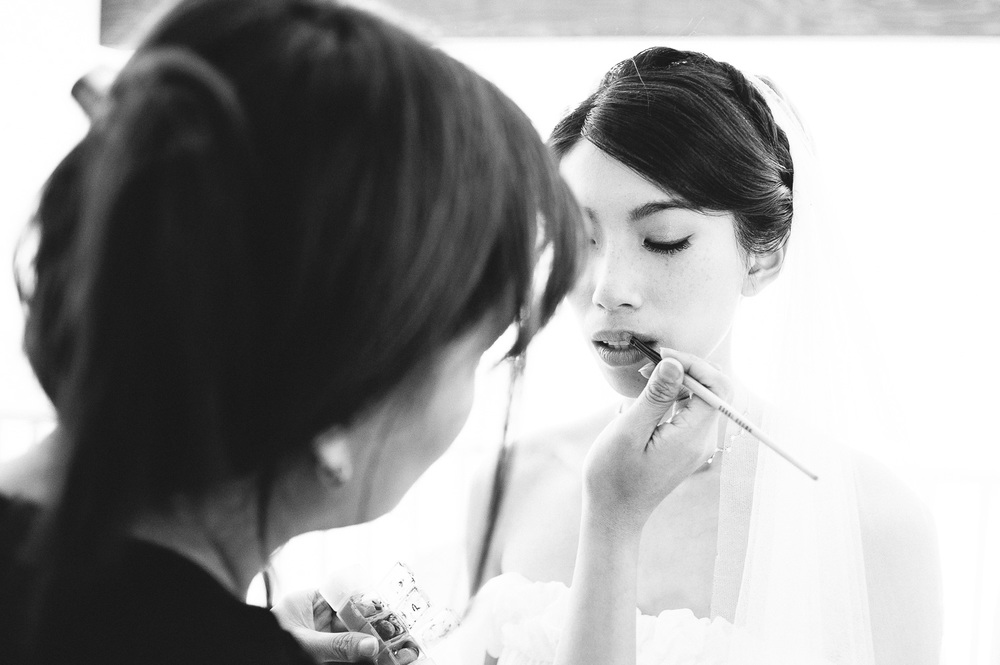 bride getting her make-up fixed