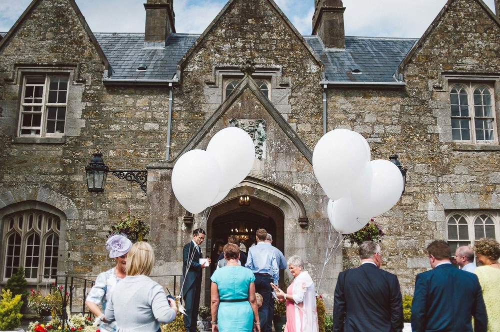 Balloons and guests outside Parkanour Manor House Wedding