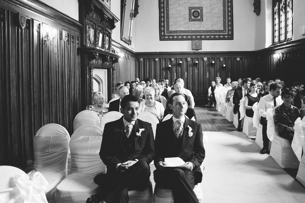 groom and best man sitting together