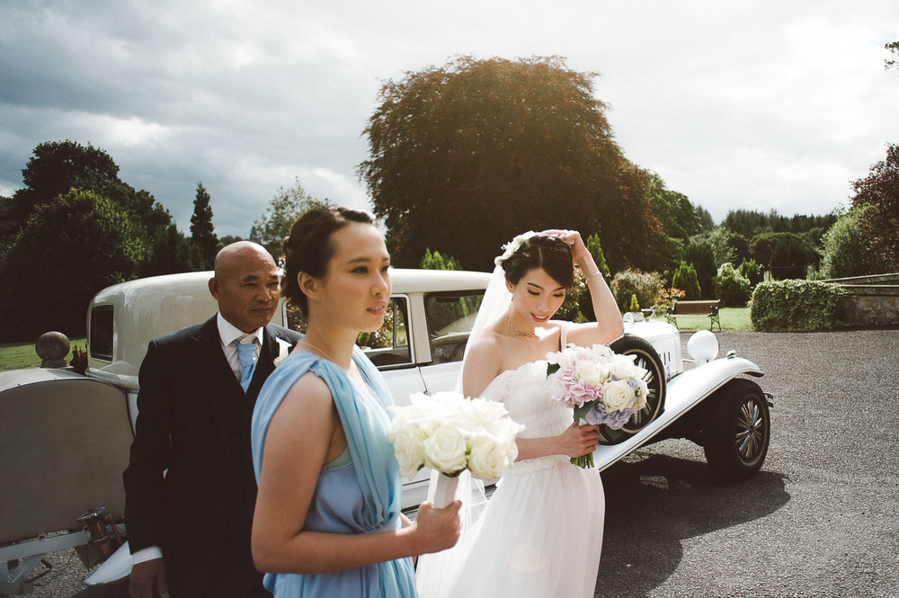 bride steps out of wedding car. Parkanour Manor House Wedding.