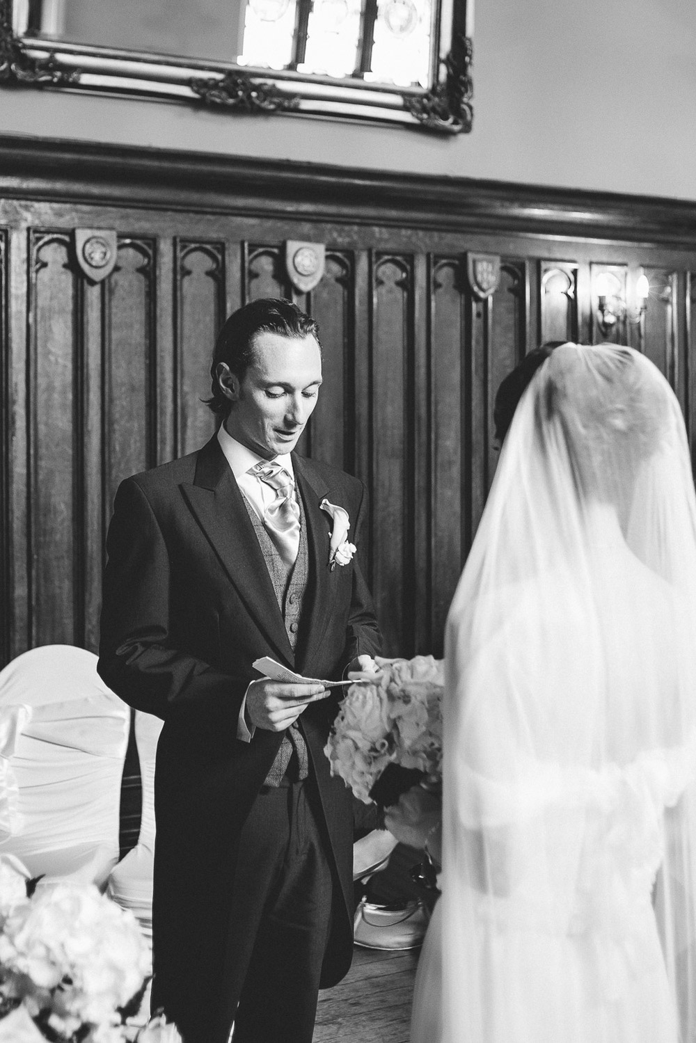 Groom reads his vows to the bride