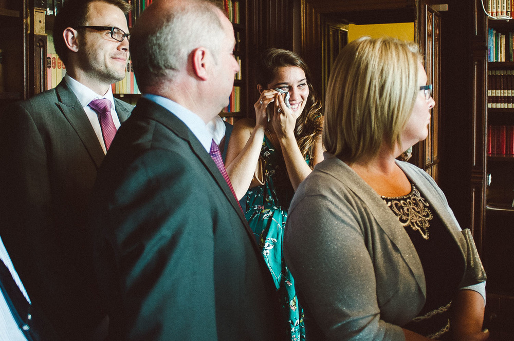 wedding guests wipes away tears