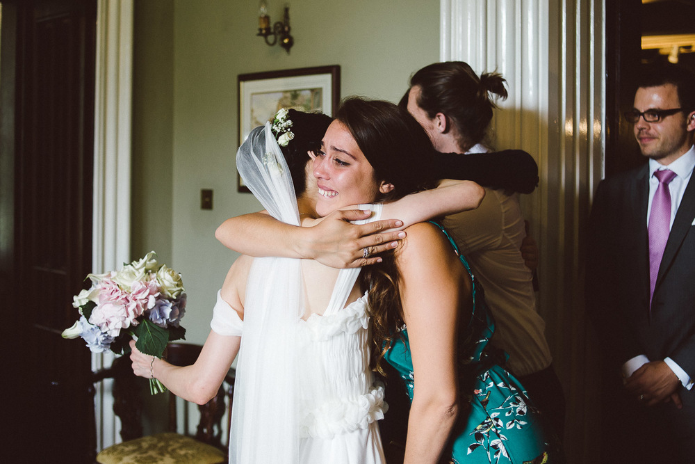 wedding guests hugs the bride