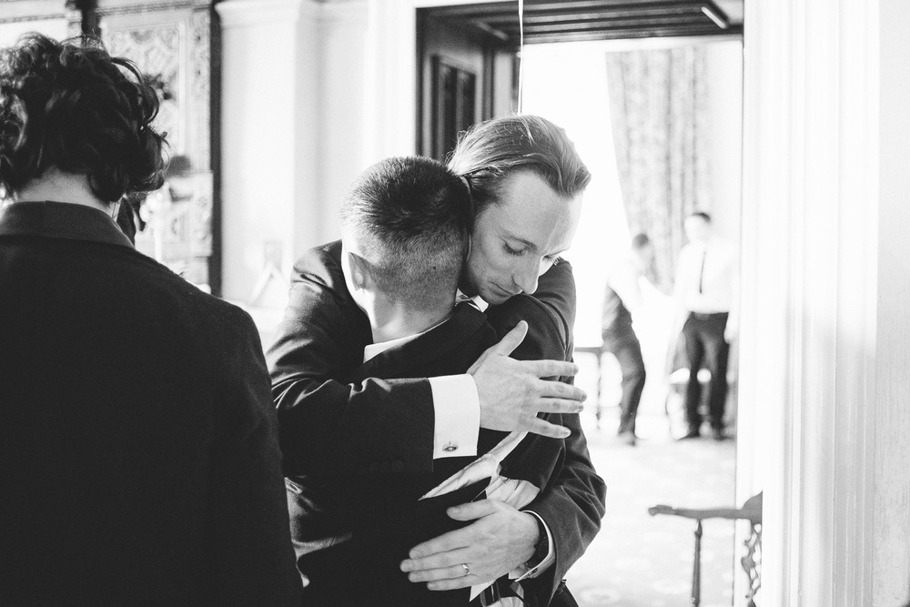 groom hugging his wedding guest
