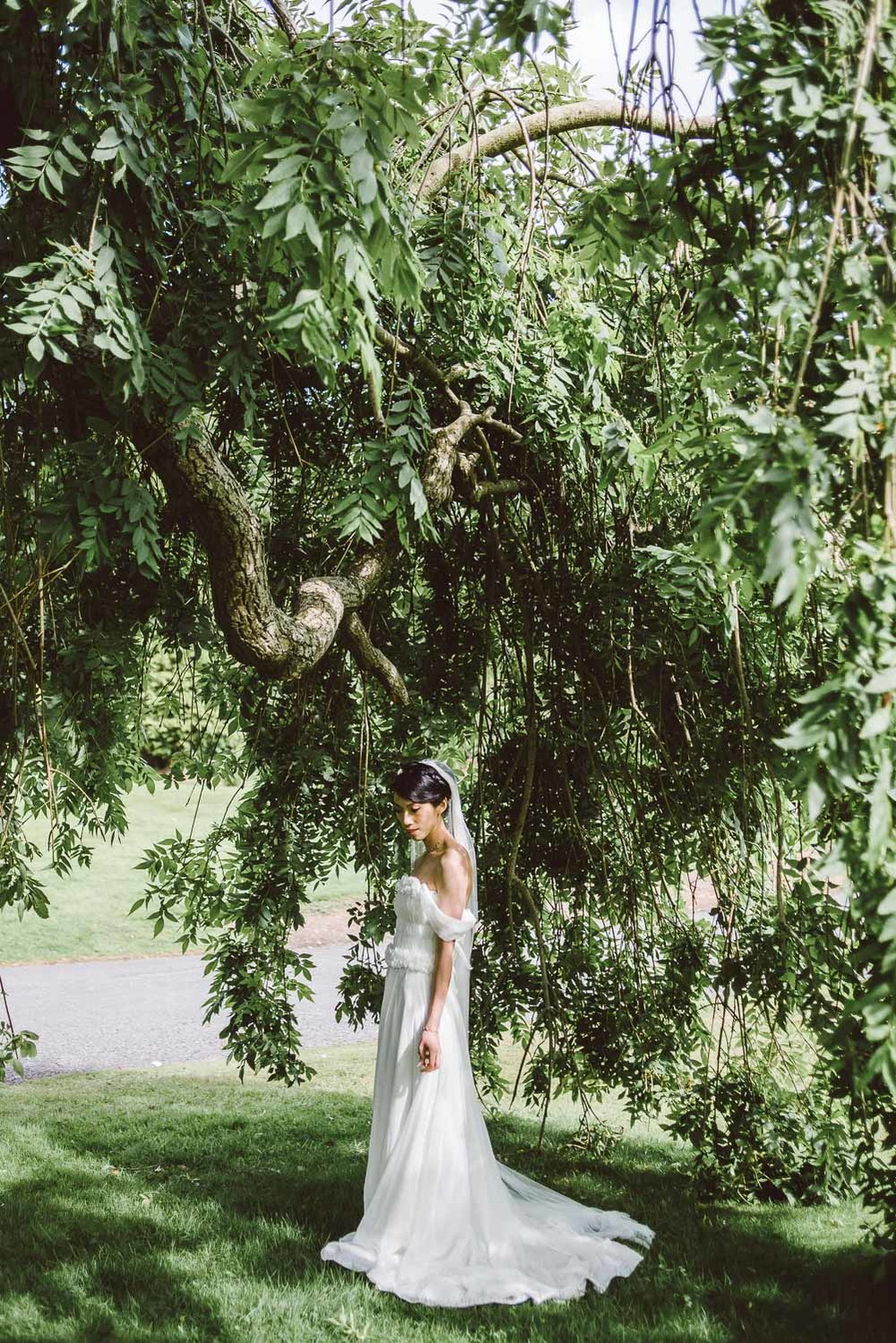Parkanour Manor House Wedding. bride in beautiful light under tree.