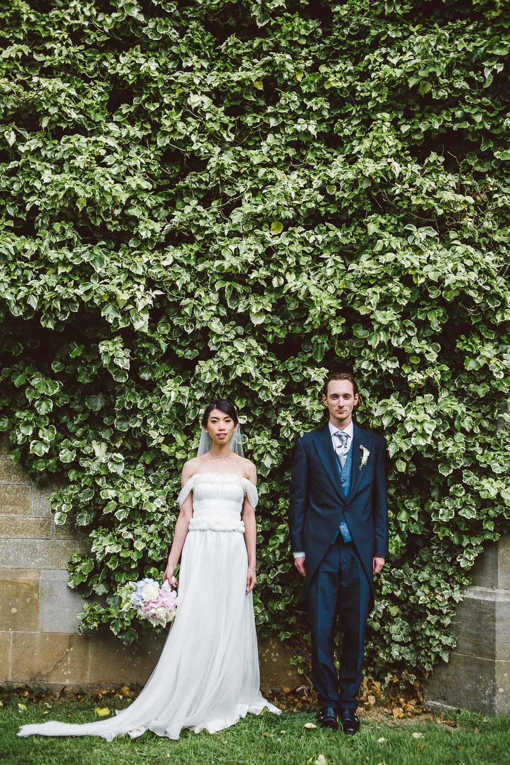 Bride and groom in front of ivy wall. Parkanour Manor House Wedding.