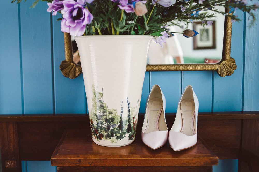 wedding shoes displayed on table