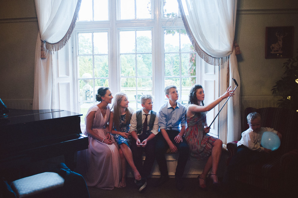 wedding guests taking a selfie.