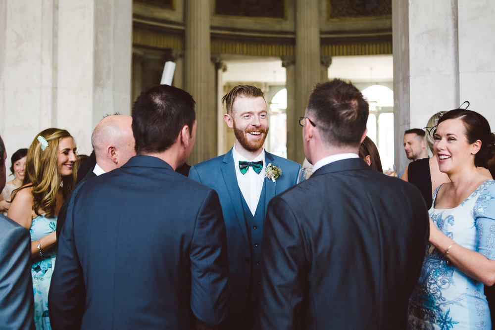 groom mingling with guests