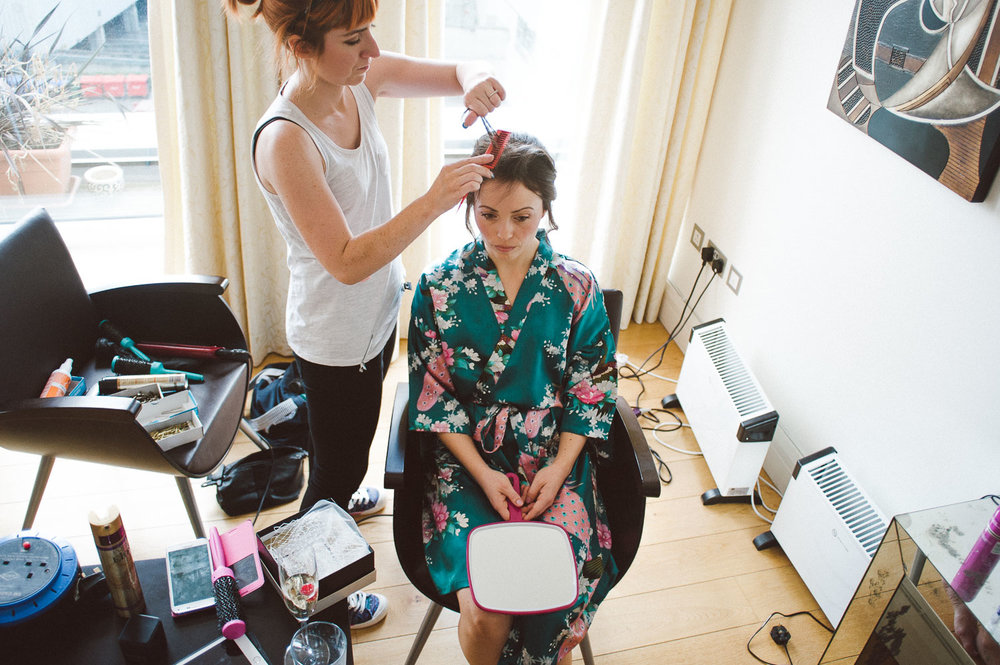 bride in kimono getting hair done
