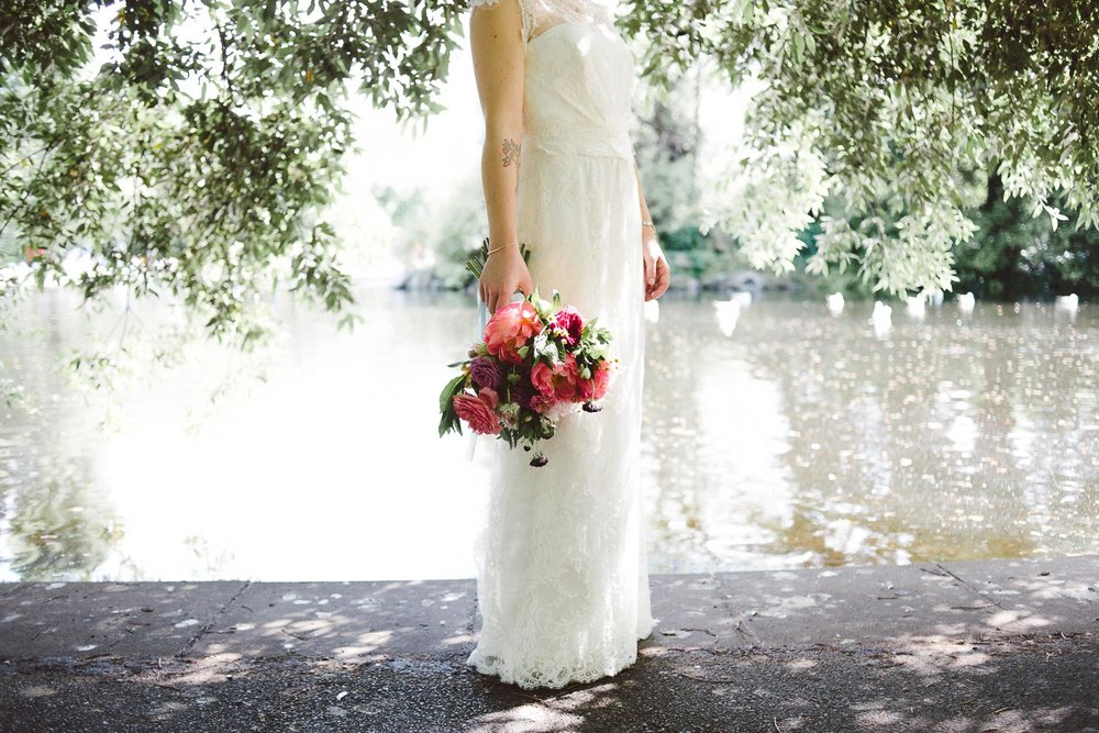 bride holding pink wedding flowers
