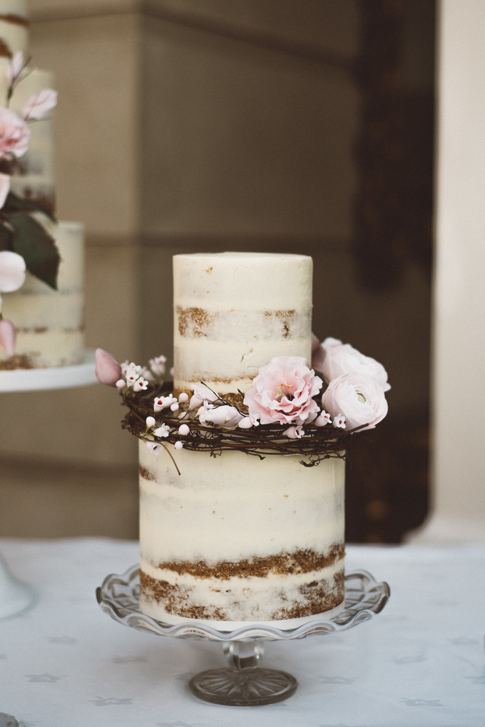 wedding cake with pink flowers and twigs
