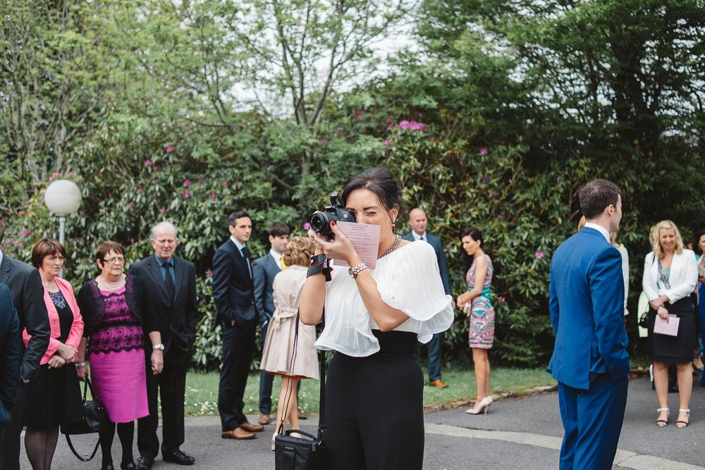 wedding guest takes photograph