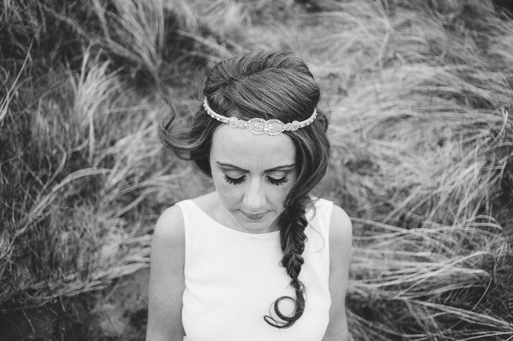 brides hair in loose plat with boho headband