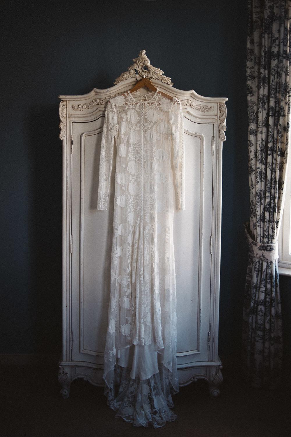 Castle Leslie Wedding. Rue de sien wedding dress hanging on wardrobe door