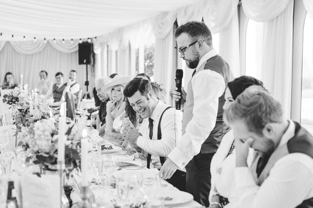groom laughing at his brothers speech