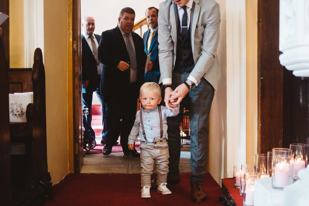 Little toddler dressed for a wedding