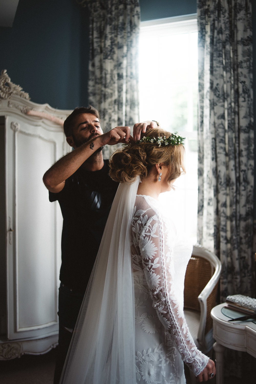 Bride gearing hair fixed by hair stylist. Castle Leslie Wedding.
