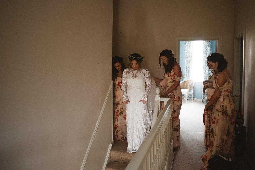 bride walking down stairs. Castle Leslie Wedding.