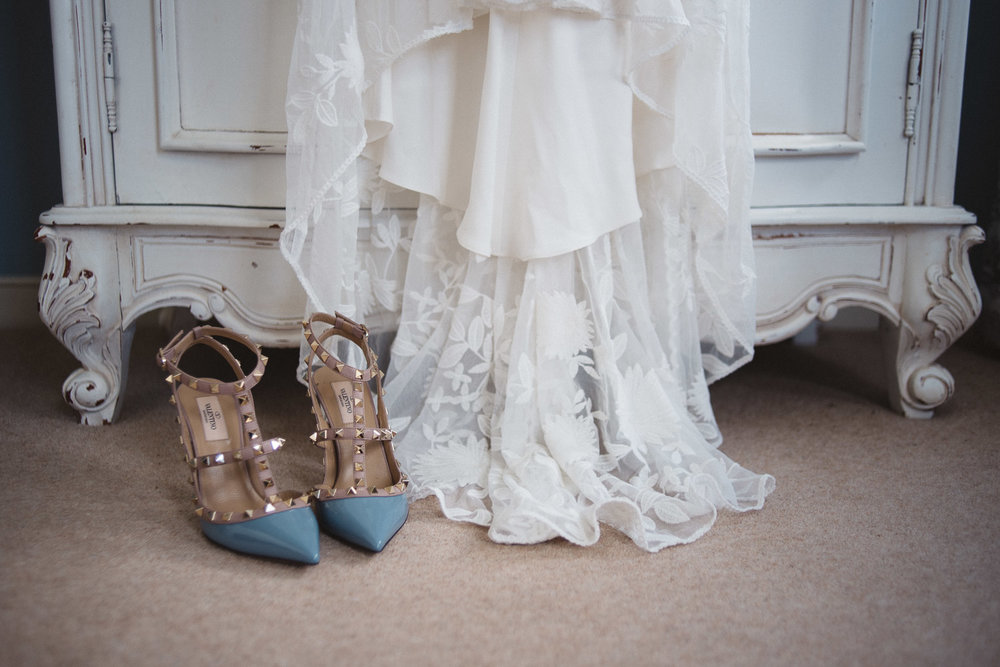 close up of brides shoes and wedding dress