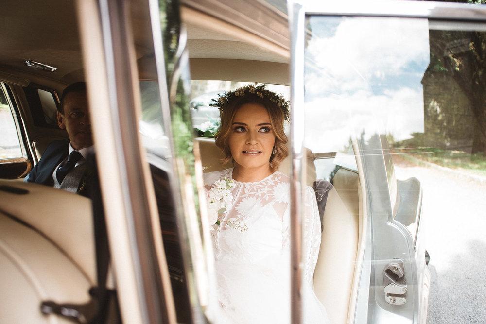 Beautiful bride in wedding car, Castle Leslie Wedding.