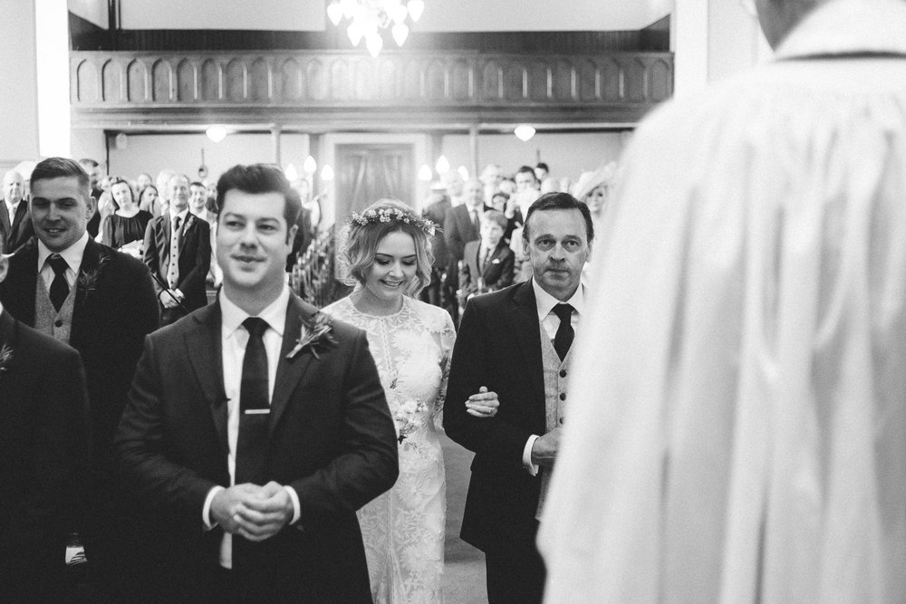 bride walks up aisle with father approaching the groom Castle Leslie Wedding.