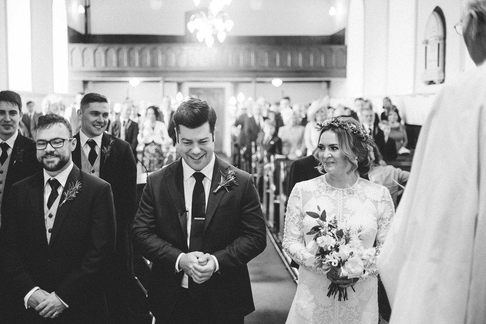Groom looks very happy to see his beautiful bride