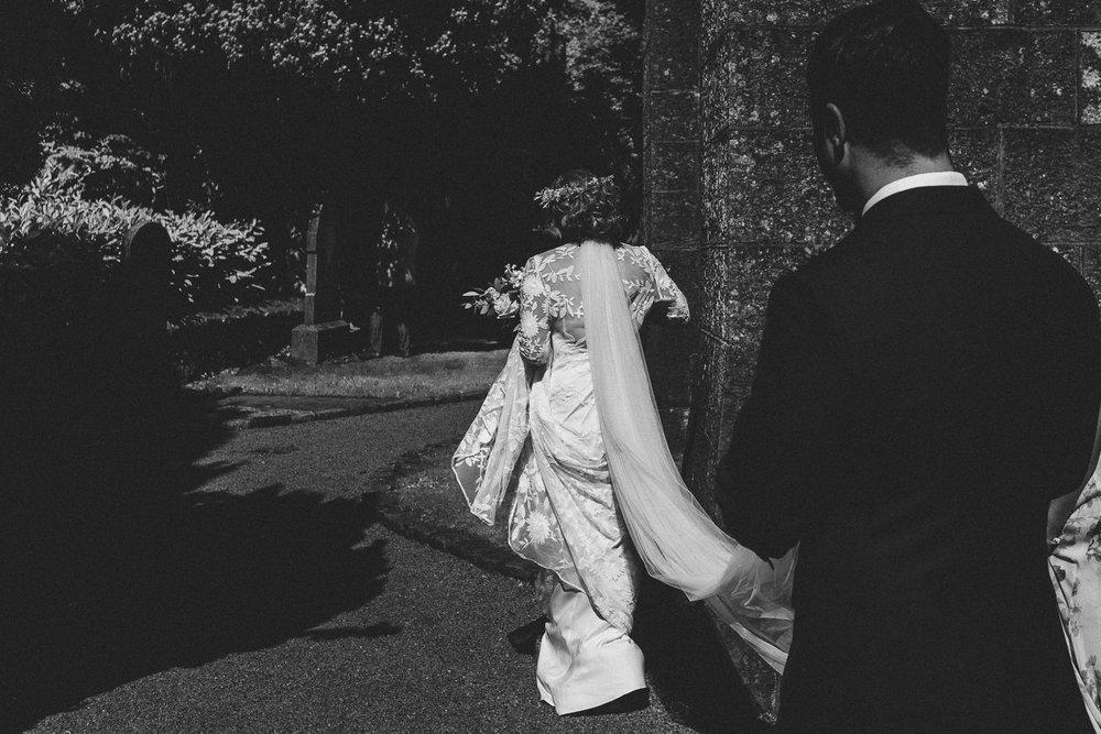 groom carries brides veil outside. Castle Leslie Wedding.