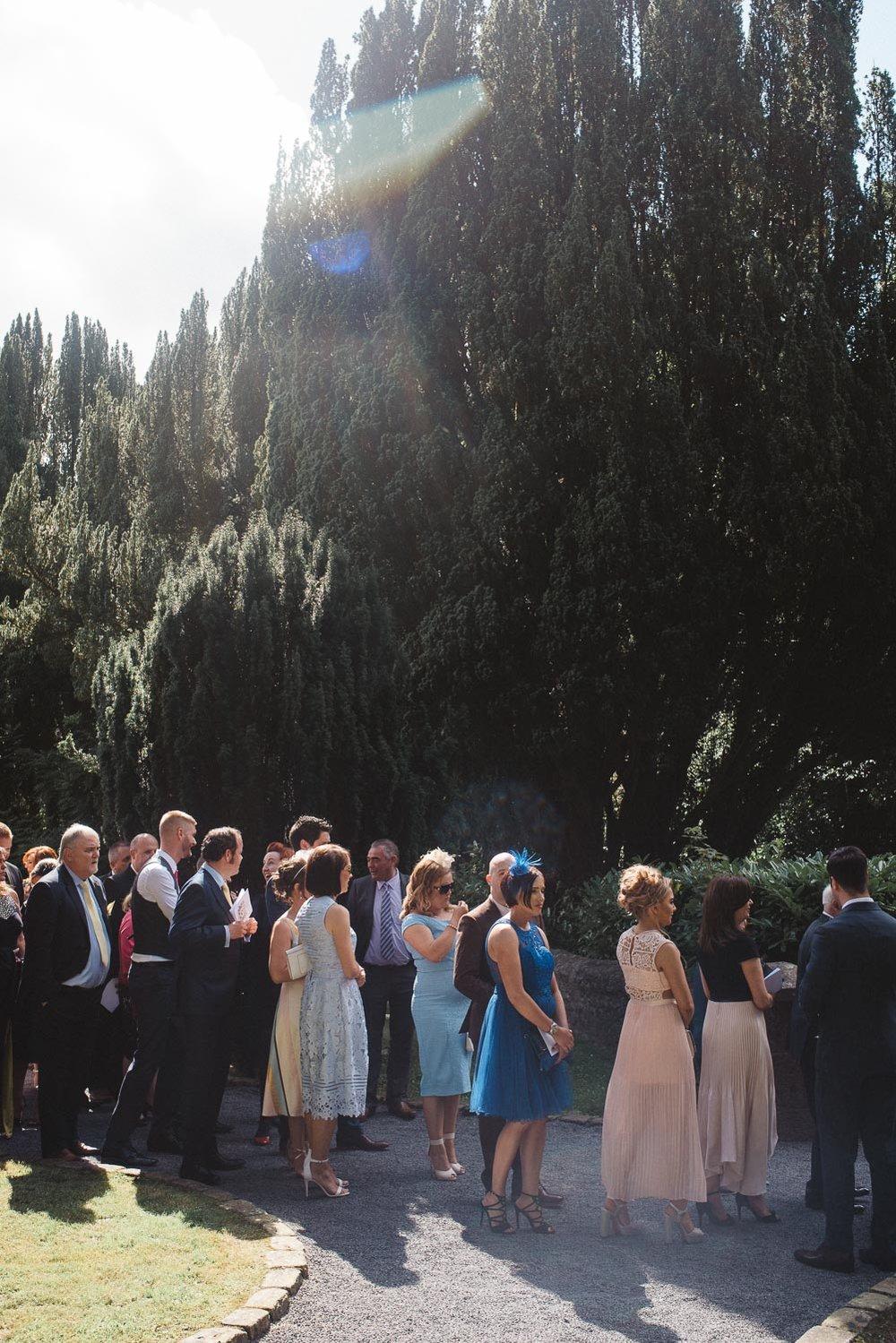 Guests mingling outside chapel.