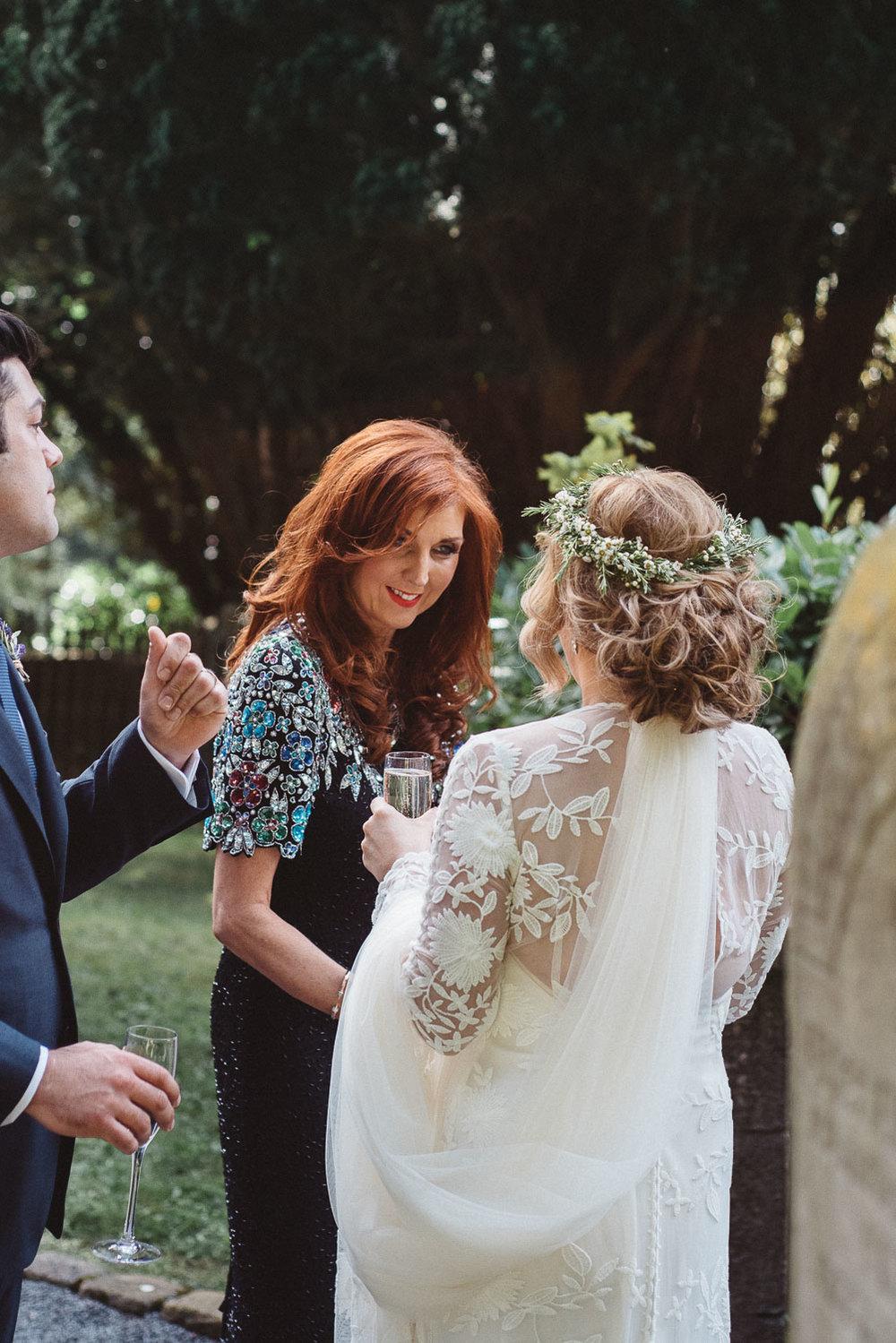 Wedding guests congratulates the bride.