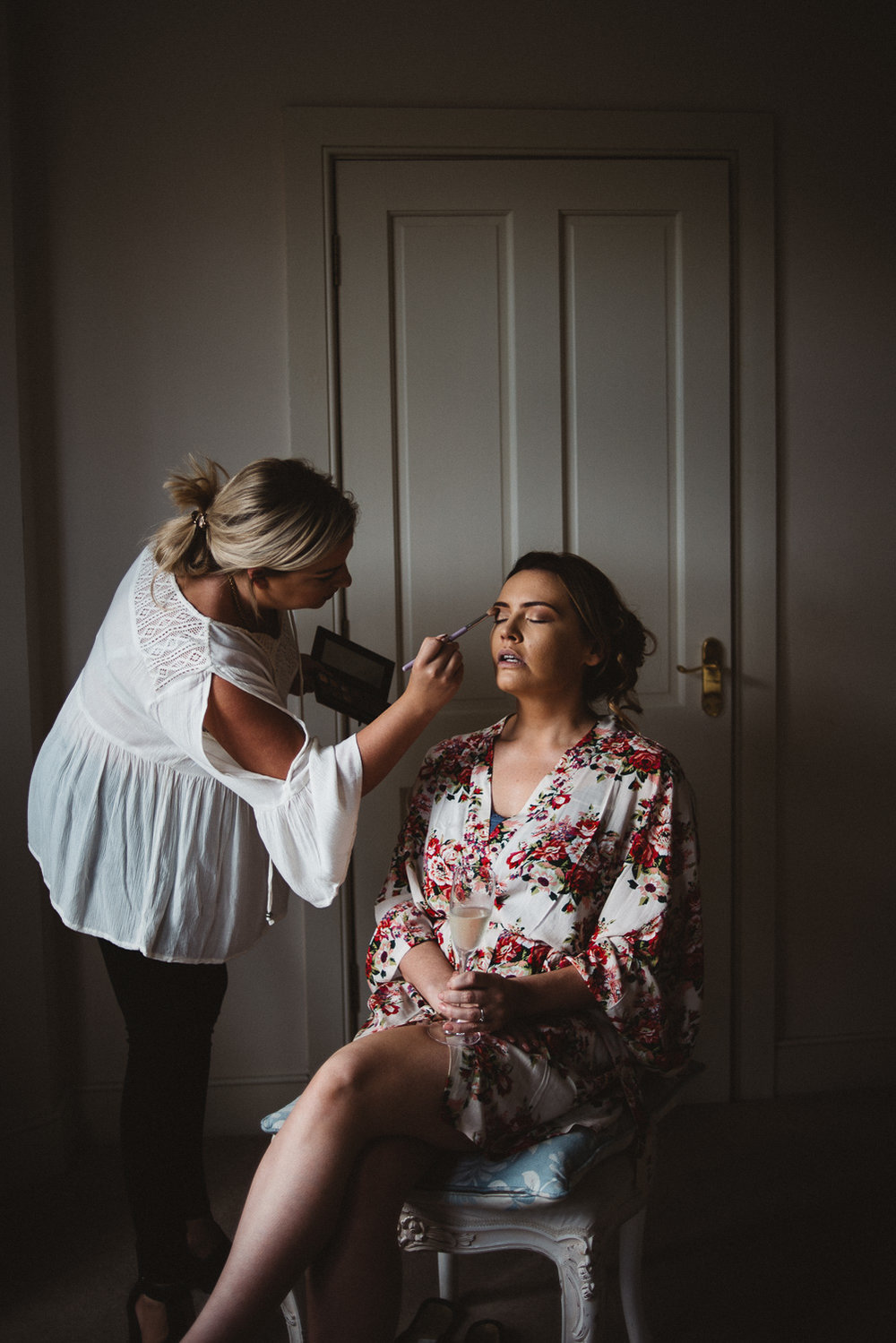 bride sitting for make up